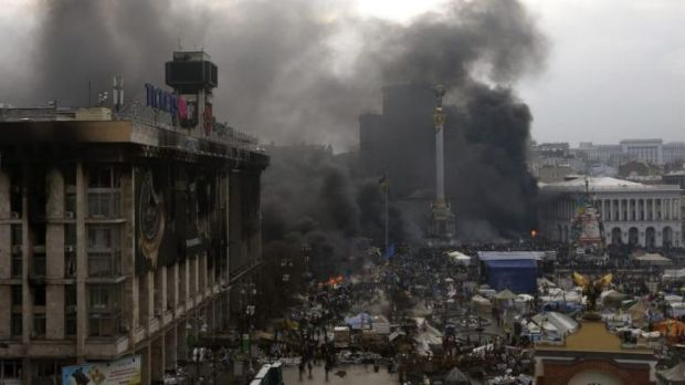 Smoke from burning barricades rise above Independence Square on Thursday.