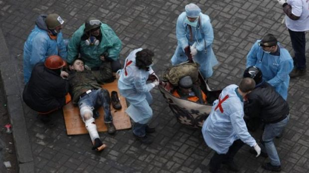 First aid workers attend to injured protesters in Independence Square on Thursday.