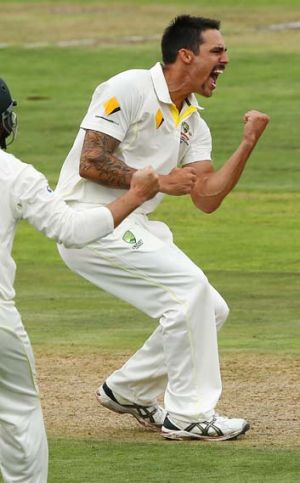 Mitchell Johnson celebrates the wicket of Hashim Amla.