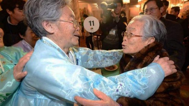 North Korean Kim Seok-Ryeo, 80, greets her South Korean sister Kim Sung-yun on Thursday.