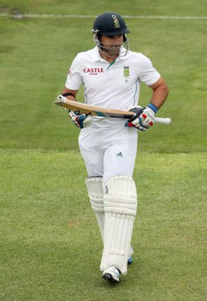 Important knock ... Dean Elgar of South Africa leaves the field after getting out to Nathan Lyon of Australia for 83.
