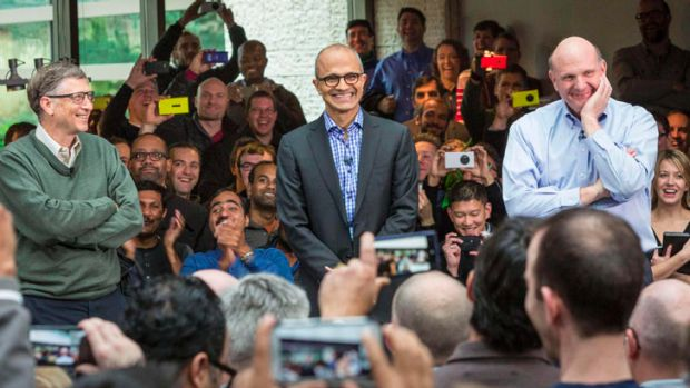 Satya Nadella (C), Microsoft's new CEO, addresses employees along with founder and technology advisor Bill Gates (L) and ...