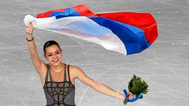 Controversy: Russia's Adelina Sotnikova celebrates holding her flag at the end of the Figure Skating Women's free ...