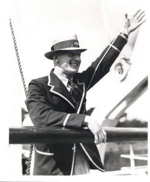 Roosters centre Dave Brown waves to the crowd as he sets off for England in 1936.