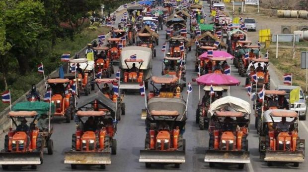 Farmers drive their tractors and other farming vehicles in Ang Thong province, towards Bangkok.