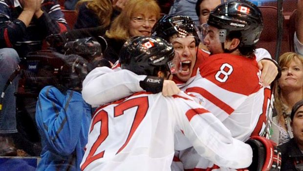 Sidney Crosby celebrates Canada's overtime gold medal win over the US in 2010.