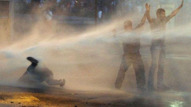 Supporters of opposition leader Leopoldo Lopez are hit by a police water canon during a protest in Caracas, Venezuela.