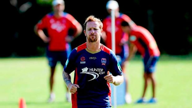 Taking flight: New Jets signing David Carney at training.