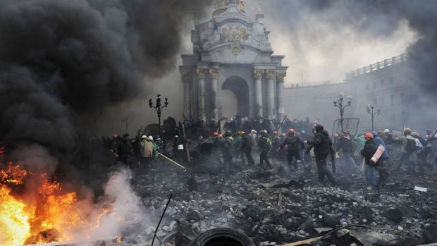 Lines of protesters taking up positions as fires burn in the heart of Kiev.