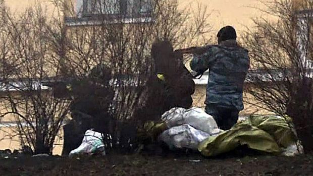 Government forces fire on protesters in Kiev on February 20.