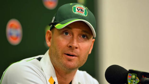 Australian cricket team captain Michael Clarke with a VB logo on his hat.