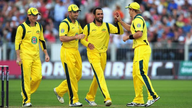 Australian bowler Fawad Ahmed, second from right, has declined to wear alcohol sponsorship on his shirt due to his ...