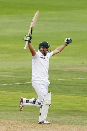 A.B. de Villiers celebrates reaching his century on day two of the second Test against Australia.