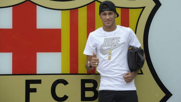 Neymar gestures upon his arrival at the club's office at the Camp Nou stadium in Barcelona, Spain.