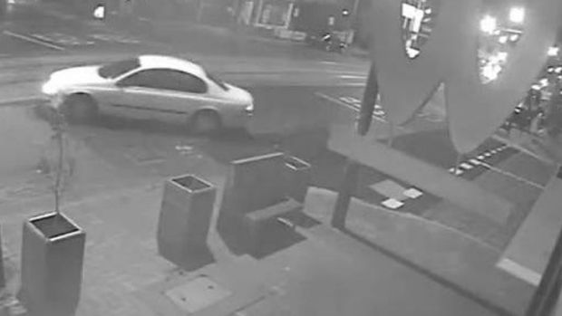 A car filmed leaving the scene of a shooting at a Brunswick East pizza store.