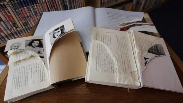 "Vandalism: Torn copies of Anne Frank's ""Diary of a Young Girl"" and related books at Shinjuku City Library in Tokyo."