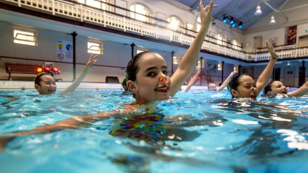 Artistic athleticism: Synchronised swimmers put on a show at the City Baths as part of the White Night.