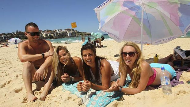 Used Facebook: Sarah Heath (second from left) and her friends arranged to meet after posting a photo of Bondi Beach.