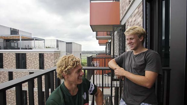 Too good to leave: Ned Hanigan, left, and Andrew Deegan on the balcony of their new student accommodation at the ...