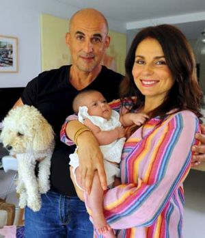 Delighted: Mary Coustas, husband George Betsis and baby girl Jamie at home.