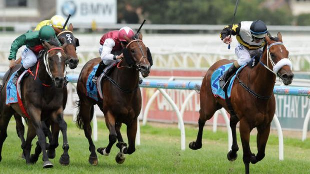 Peak form: Luke Nolen riding Moment of Change wins the Futurity Stakes at Caulfield.