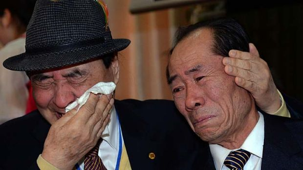South Korean Jung Hee-Kyung (left) bids farewell to his North Korean relative.