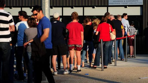 Fans line up to get into Canberra Stadium on Saturday night following a ticket bungle by the Brumbies.