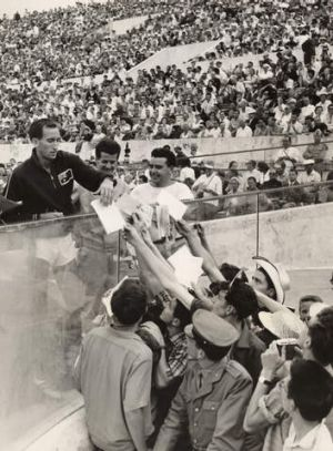 Running man: Elliott celebrates with fans after winning gold at the 1960 Rome Olympics.