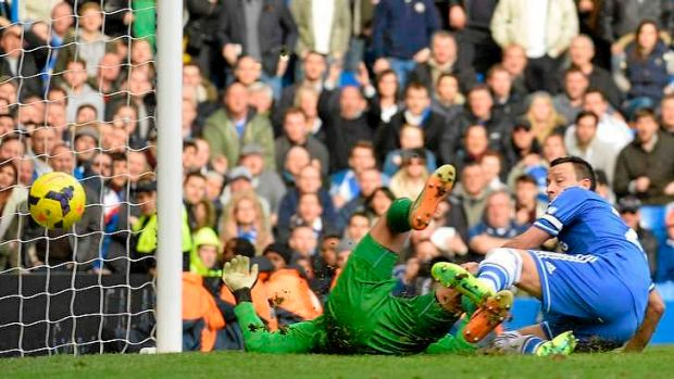 Late drama: Chelsea skipper John Terry reacts as Everton's Tim Howard scores an own goal in injury to hand the Blues victory.