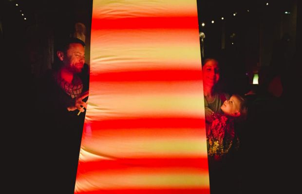 Family having fun iwth light installations on Flinders lane. Photo by James Boddington