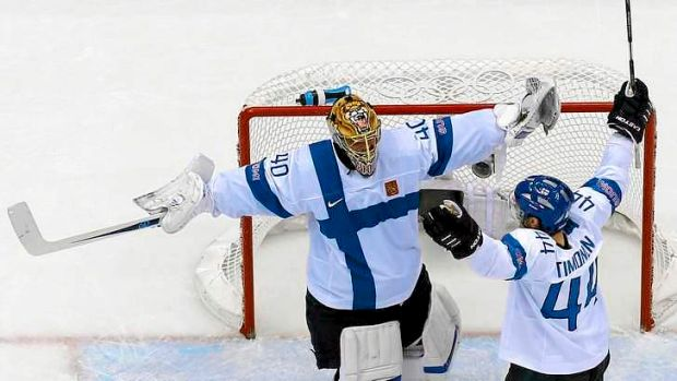 Finishing school: Finland  celebrate after thrashing USA 5-0 in the men's ice hockey bronze medal game.