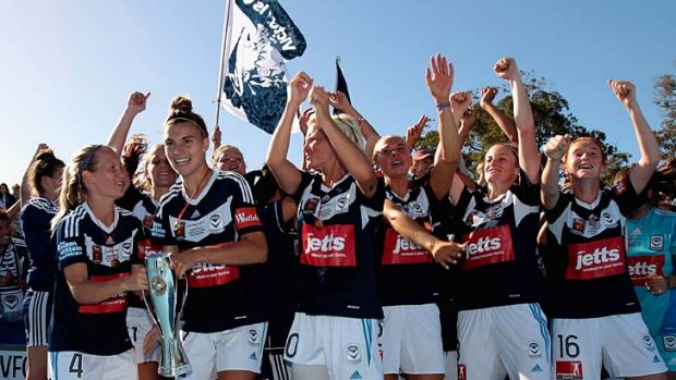 Melbourne Victory players celebrate after winning the W-League grand final against the Brisbane Roar at Lakeside Stadium ...