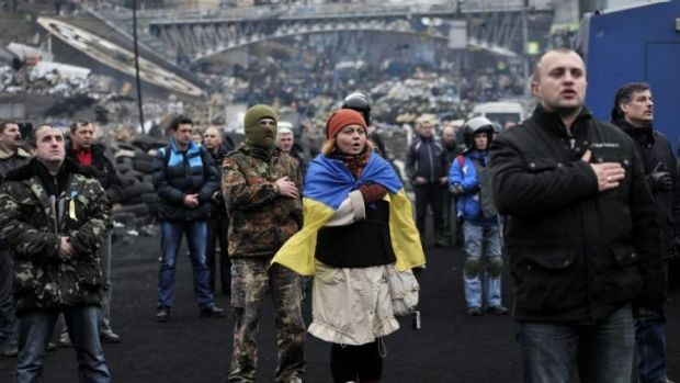 Protesters sing the Ukrainian national anthem at the square on February 22.