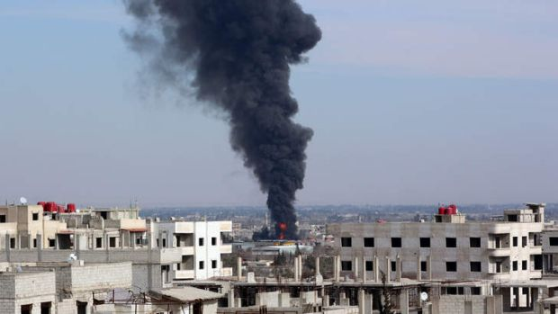 Smoke billows from the site of reported airstrike by pro-regime planes in the eastern Ghouta suburb of Damascus.