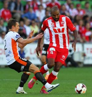 Heart's Orlando Engelaar controls the ball under pressure from the Roar defence at AAMI Park on Sunday.