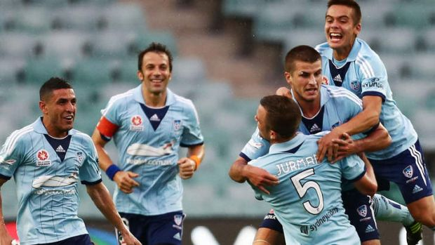 In it to win it: Sydney FC celebrate a goal during the win against Newcastle Jets.