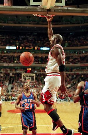 Michael Jordan dunks the ball during the game for Chicago against the New York Knicks at the United Center in Chicago in ...