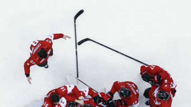 Jubilation: Canada celebrate their 3-0 win over Sweden at Sochi.