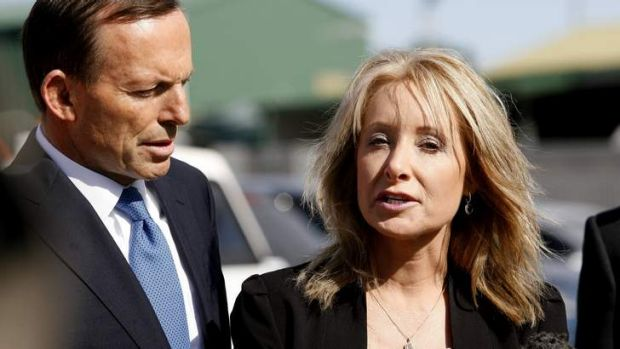 Tony Abbott campaigning with candidate now MP for Dobell Karen McNamara, who has initiated proceedings against the ...