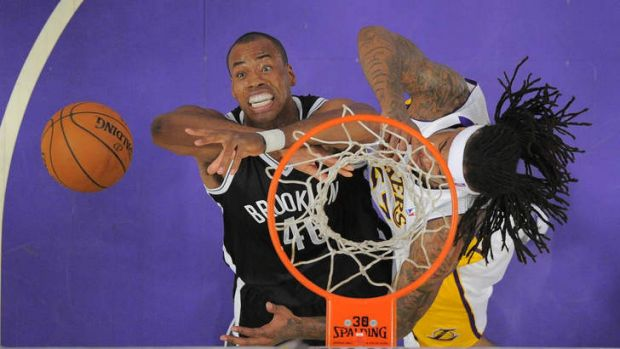 Brooklyn Nets centre Jason Collins, battles for a rebound with Los Angeles Lakers opponent Jordan Hill during the clash ...
