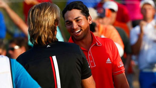 Frenchman Victor Dubuisson (left) congratulates Jason Day after the Australian prevailed in a thrilling final of the WGC ...