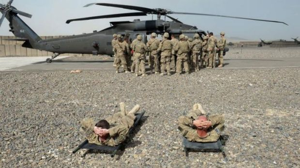 Less need for so many land-based troops: US soldiers in Afghanistan practise medical evacuations.