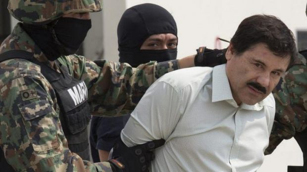"""Joaquin """"Shorty"""" Guzman  is escorted by Mexican security forces in Mexico City."""