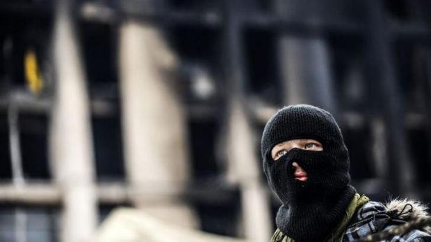 Mutineer? An anti-government protester waits at the entrance of Kiev's Independence Square on February 23, 2014.