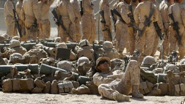 Costly: US personnel wait to begin a training exercise in Jordan in 2013. The rising costs of personnel have forced the ...