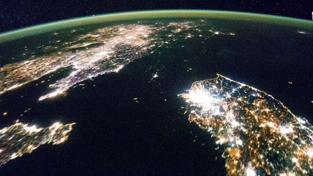 North and South Korea from space. North Korea is barely visible at night.
