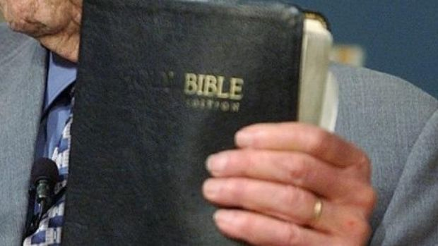 Miraculous escape ... Ohio bus driver Rickey Wagoner was saved by a bible that stopped two bullets from hitting his ...