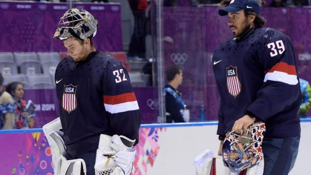 Jonathan Quick (L) and Ryan Miller leave the ice after losing the bronze medal game.