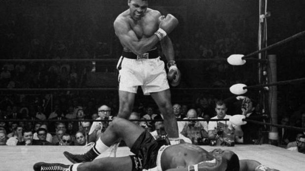 Muhammad Ali stands over fallen challenger, Sonny Liston, in their 1965 rematch.