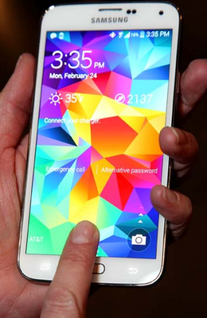 Using the Galaxy S5's fingerprint scanner.